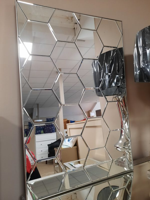 an image of an art deco mirror with hexagonal shapes