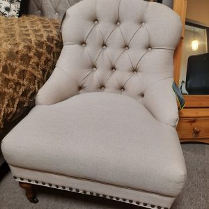an image of a beige deep buttoned accent chair
